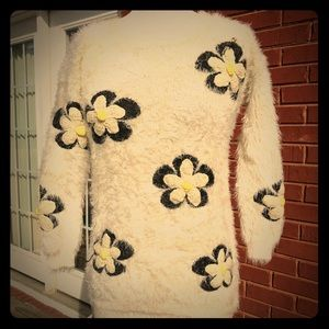 Fuzzy soft crocheted daisy sweater